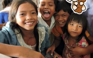 DONATING NEW CLOTHES AND GIFTS FOR CHILDREN AT CAMBODIA